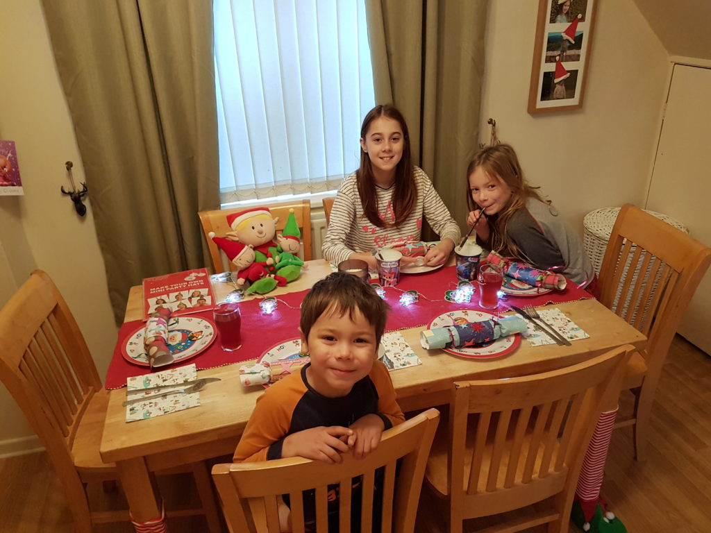 Kids sat at the breakfast table enjoying their north pole breakfast