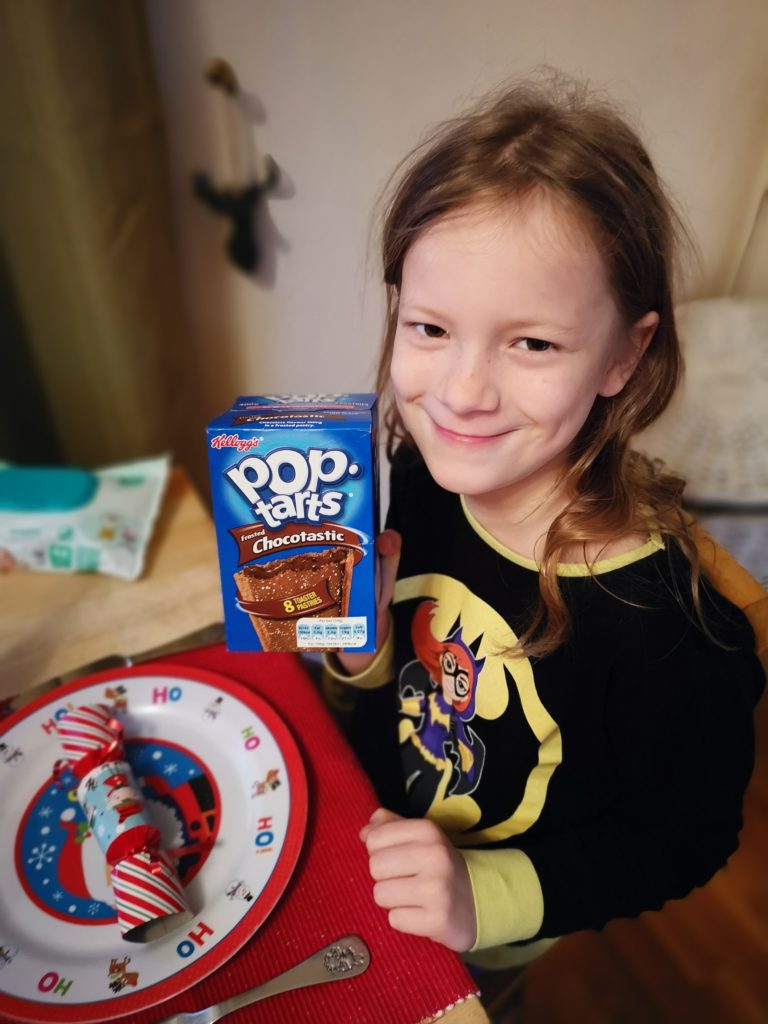 Lois holding a box of chocolate pop tarts