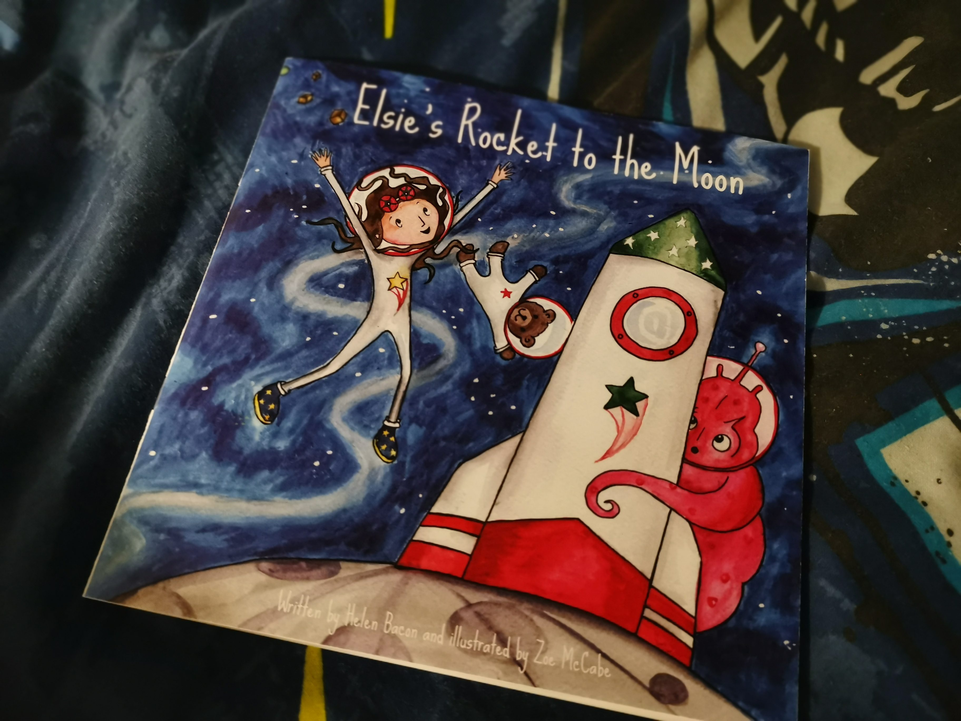 front cover of book showing girl , space rocket and alien