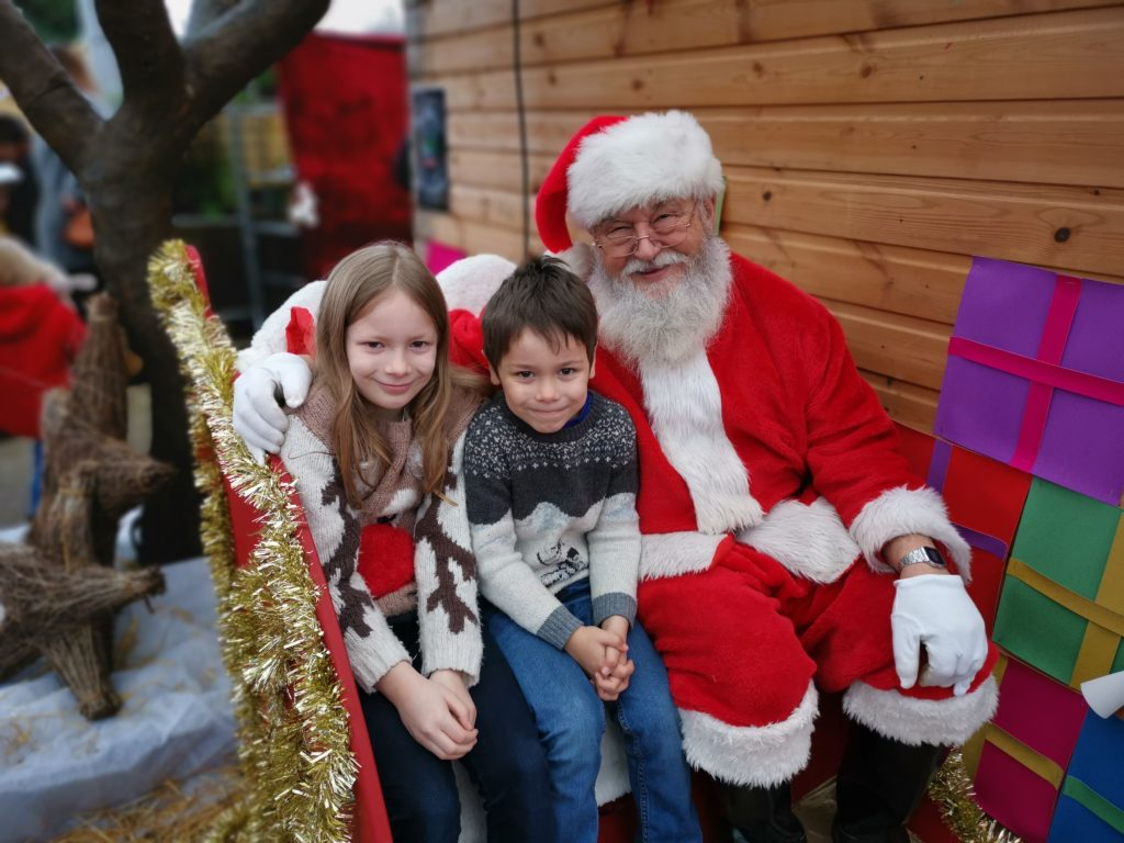 Father Christmas and kids sat on sleigh at Notcutts Garden Centre