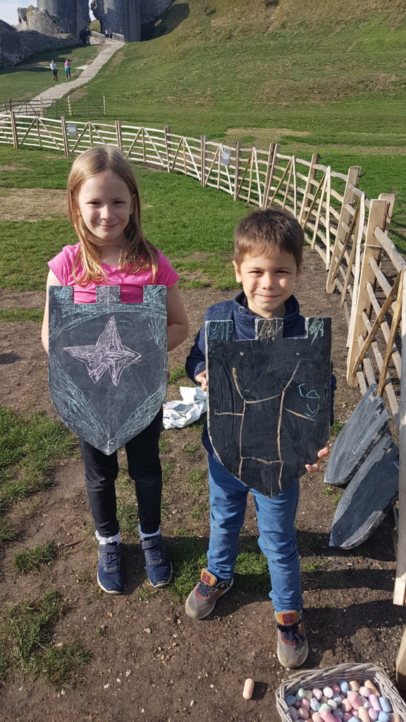 lois and cody holding their slate skields decorated with chalk
