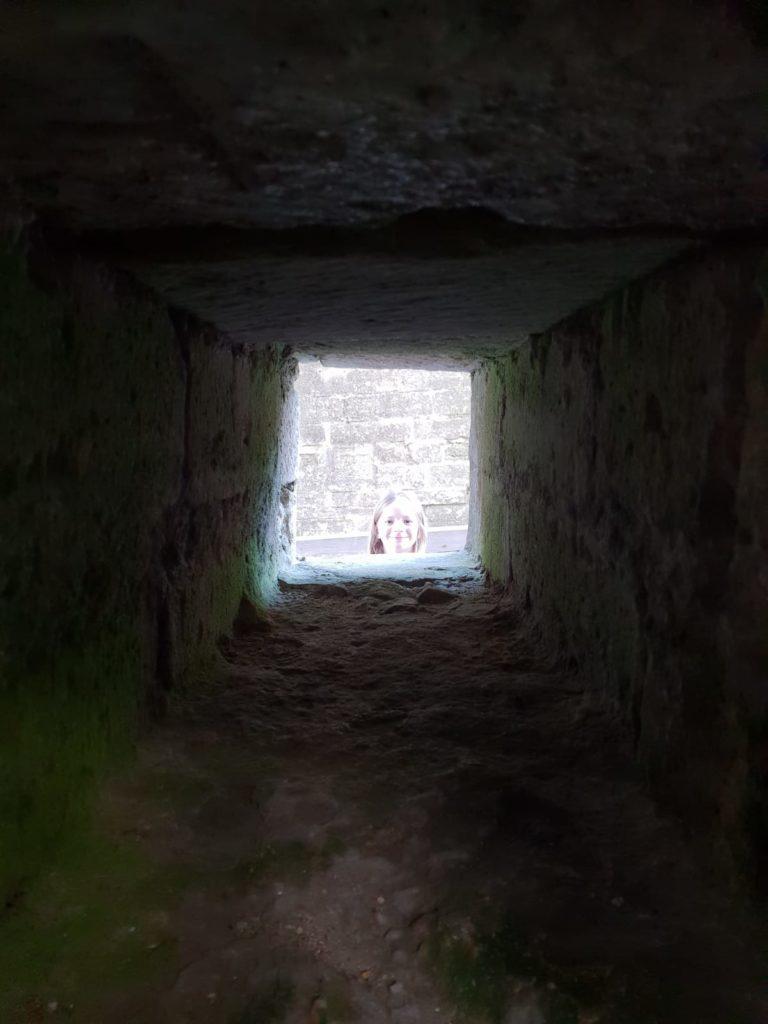 Lois peering through a nook