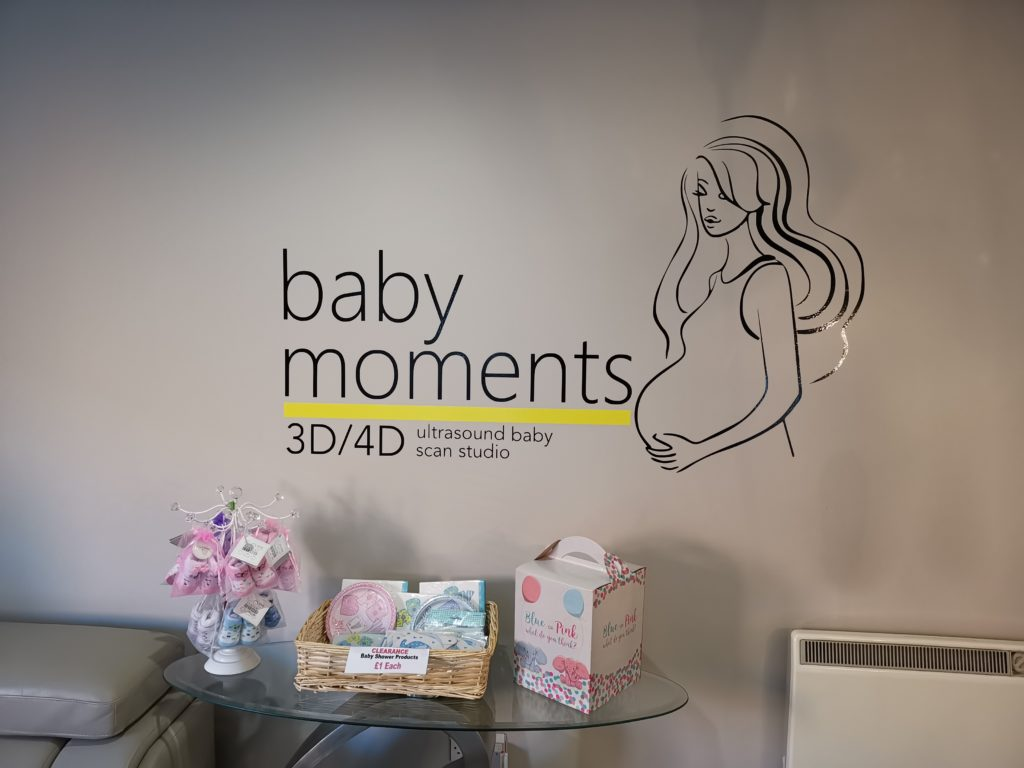 baby moments logo on wall in reception