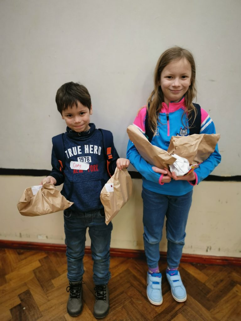 Lois and Cody holding their cookery goodies at House of Fun
