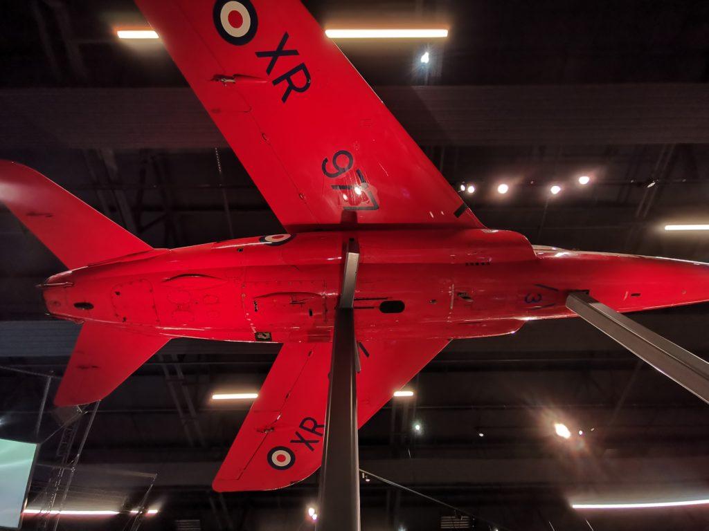 underside of a red arrow plane