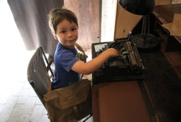 Cody with a typewriter at Hughenden Manor