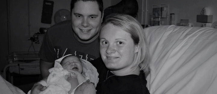 new parents with baby in hospital