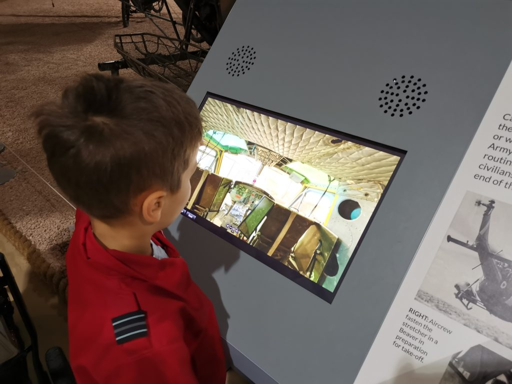 Cody using interactive screen to see inside helicopter