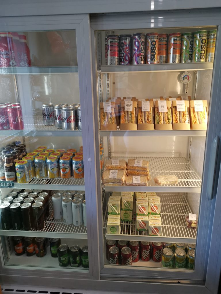 fridge with lunch items available to purchase including drinks, sandwiches, etc