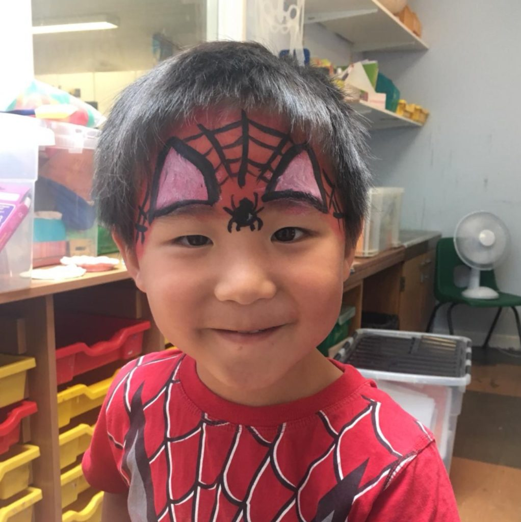 little boy with spiderman tshirt and face paint at house of fun