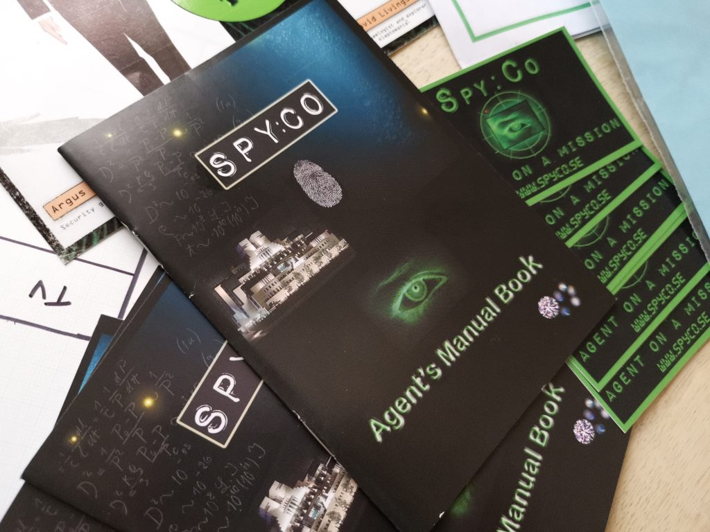 Spy:co agent manual. Black paperback booklet