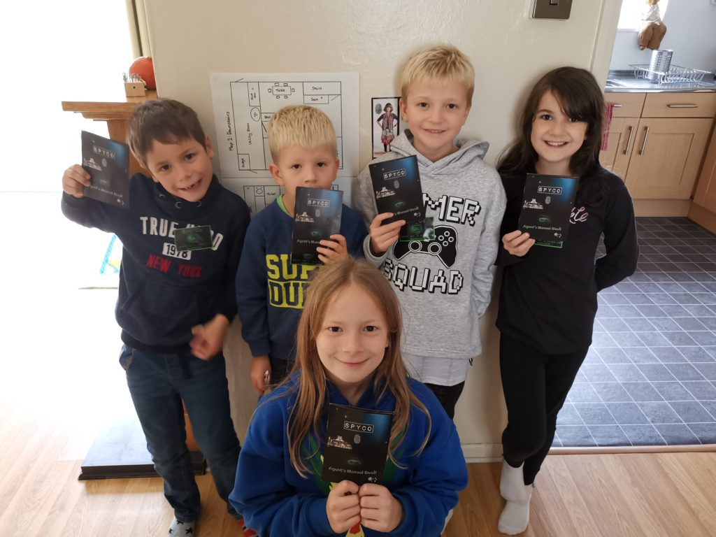 Group of children with their Spy:Co agent manuals