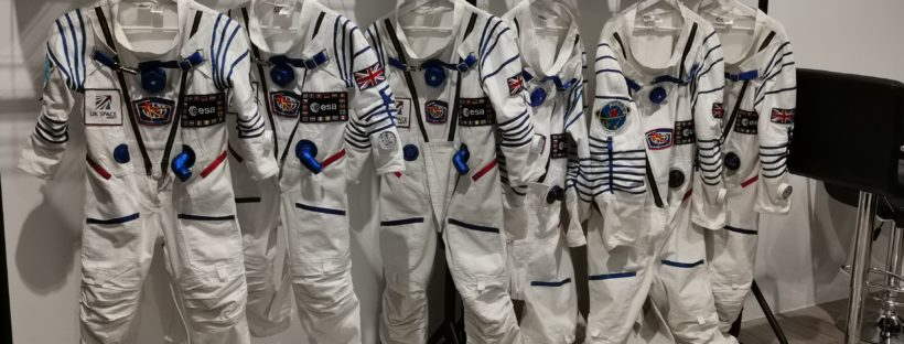 space suits hanging on a rail at the Space Store in Didcot