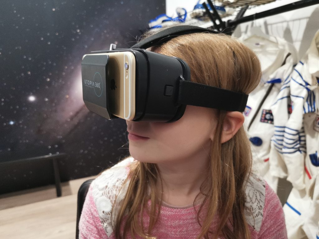 Lois wearing a virtual reality headset at the space store