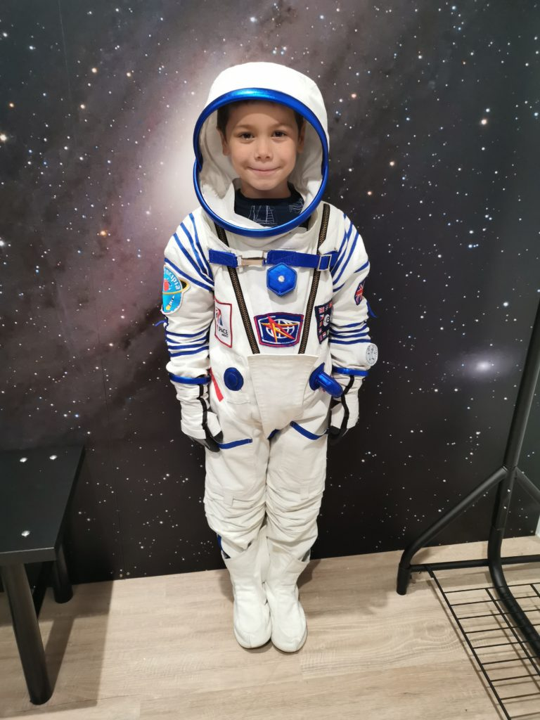 Cody wearing a replica Tim Peake astronaut space suit at the space store