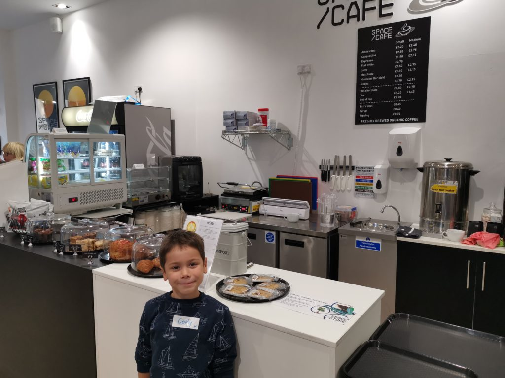 Cody stood in front of the counter at the Space store cafe