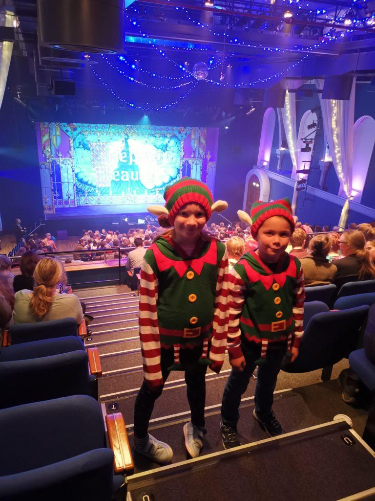 Kids dressed as elves stood on steps in the theatre at Corn Exchange Newbury