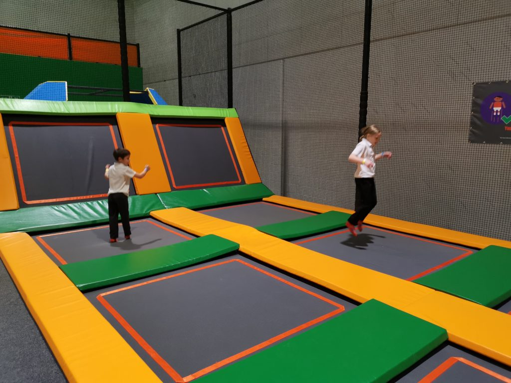 Kids bouncing on the trampolines inside the trampoline park at carterton
