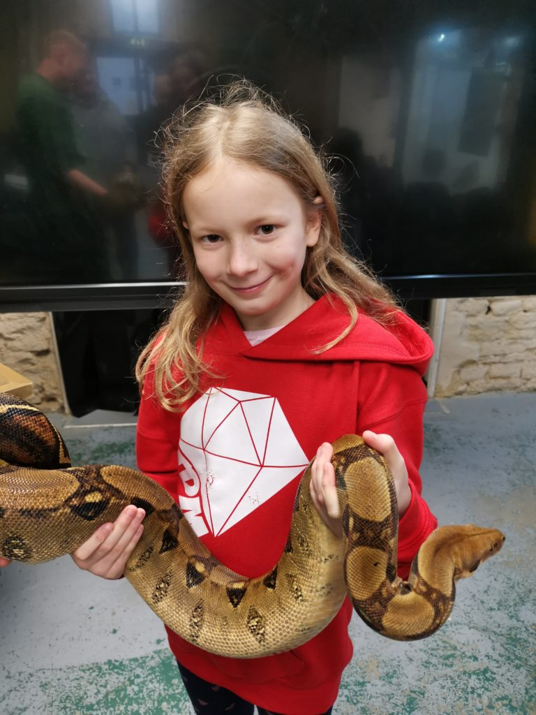 Lois holding a boa constrictor at Crocodiles Of The World