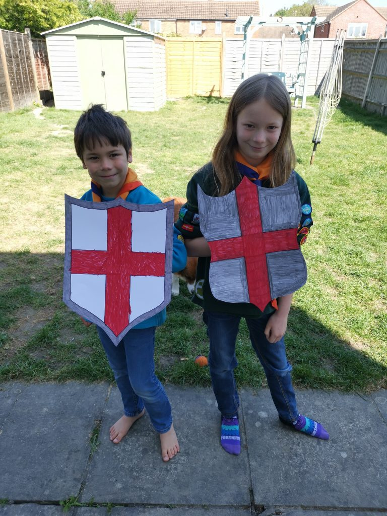 kids holding their st georges day shields