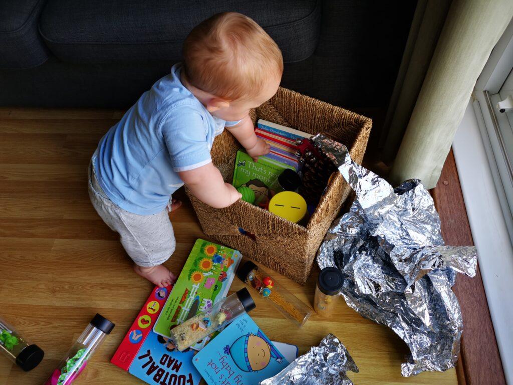 Baby with his sensory play box