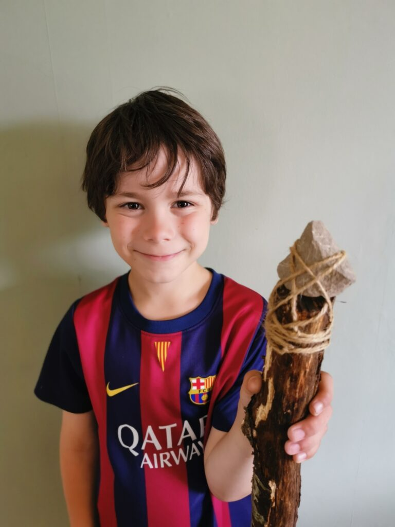 Cody holding stone age spear
