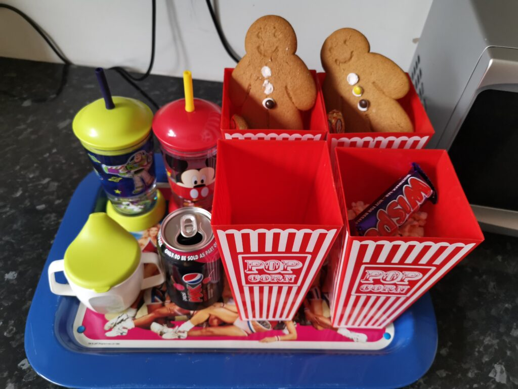 cinema snacks in popcorn buckets