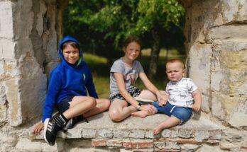 kids sat in window of castle ruin