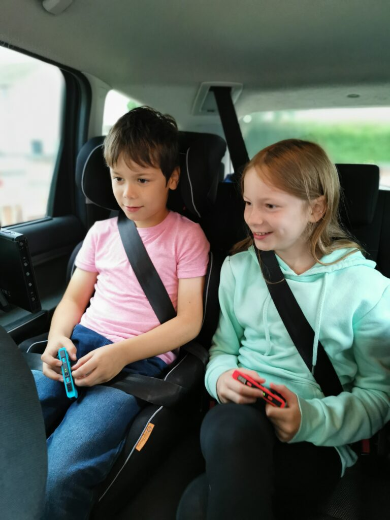 kids playing on the Nintendo Switch in the car