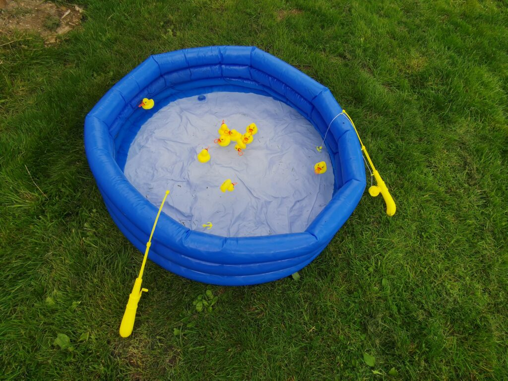 hook a duck in the paddling pool. fun family activities at home in the garden.