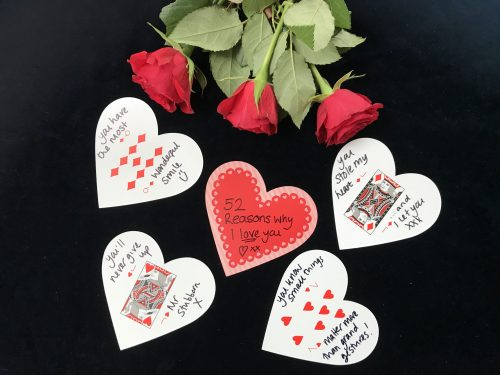 heart shaped cards with reason why i love you written on.