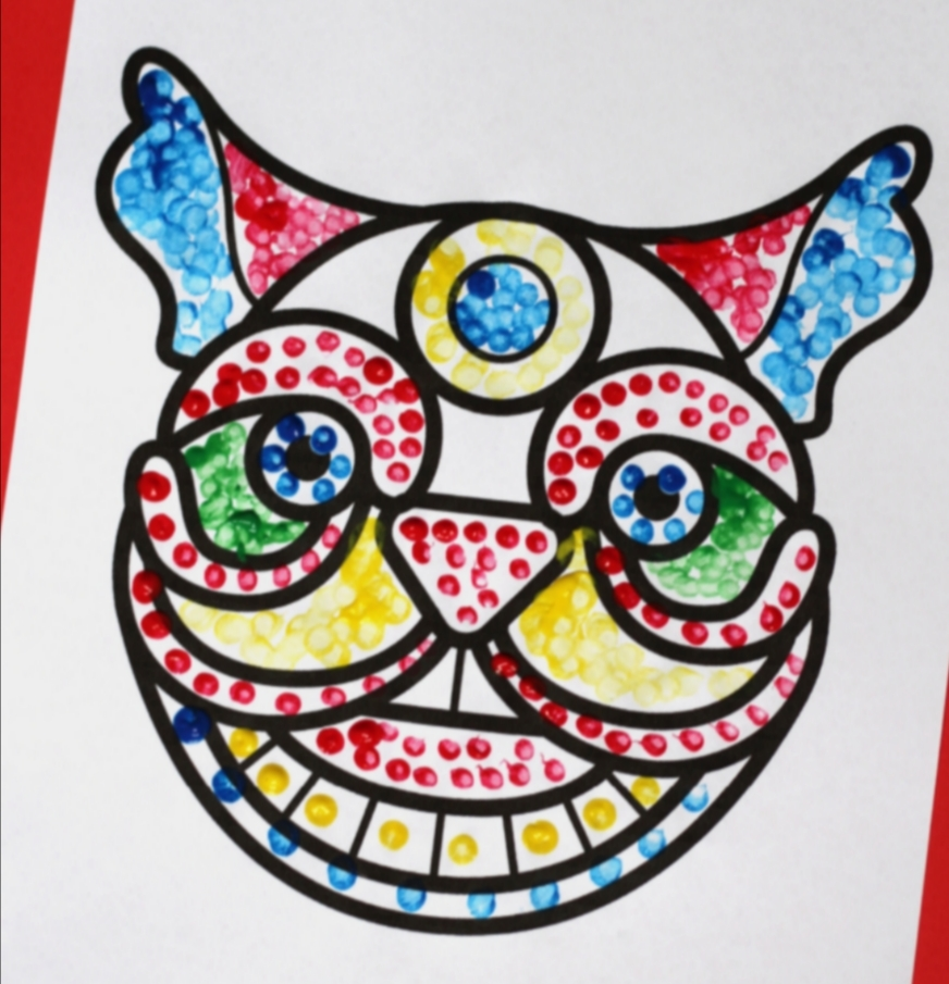 dragon face template coloured in with paint spots. Chinese New Year crafts project.