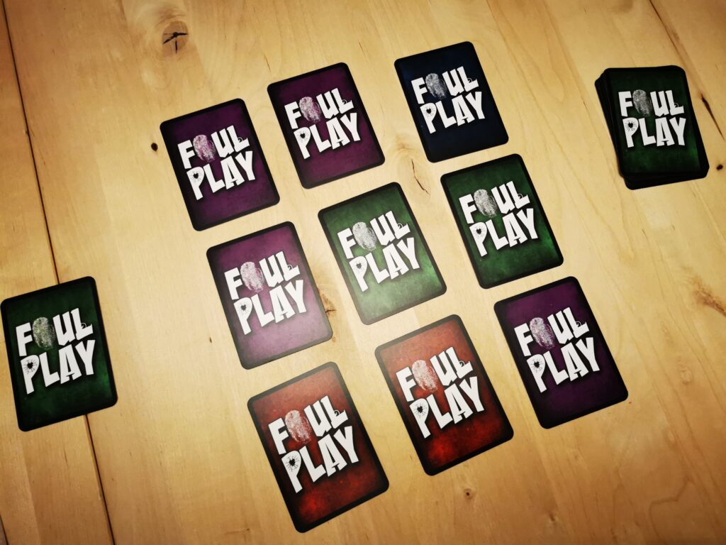 Foul Play playing cards laid face down on table