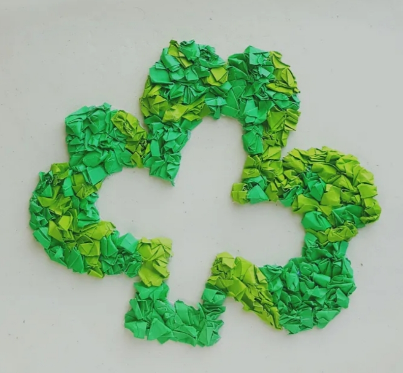 Shamrock made from scrunched up tissue paper.St Patrick's Day activities