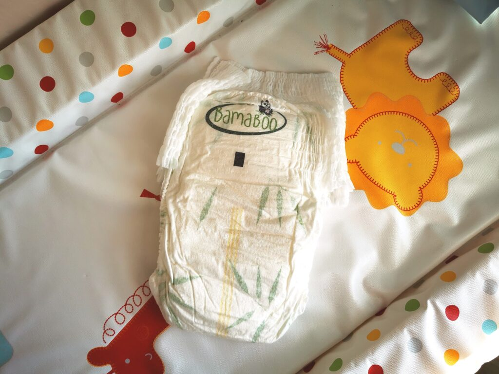 bamboo nappies laid on changing mat