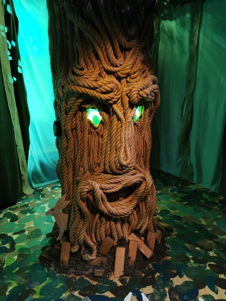 indoor tree with glowing eyes in the Whispering Wood at The Story Museum